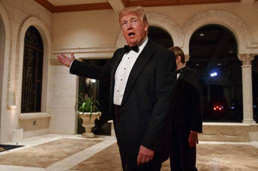 FILE - In this Sunday, Dec. 31, 2017 file photo, President Donald Trump speaks with reporters as he arrives for a New Year's Eve gala at his Mar-a-Lago resort, in Palm Beach, Fla. Trump slammed Pakistan for 'lies & deceit' in a New Year's Day tweet that said Islamabad had played U.S. leaders for 'fools'. 'No more,' Trump tweeted. Meanwhile, Pakistan had no official comment but Foreign Minister Khawaja Asif tweeted that his government was preparing a response that 'will let the world know the truth.' (AP Photo/Evan Vucci, File)