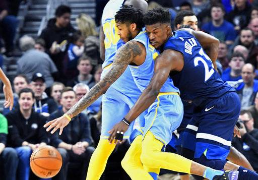 Minnesota Timberwolves' Jimmy Butler, right, tries to reach the ball as Los Angeles Lakers' Brandon Ingram drives in the first half of an NBA basketball game Monday, Jan. 1, 2018, in Minneapolis. (AP Photo/Jim Mone)