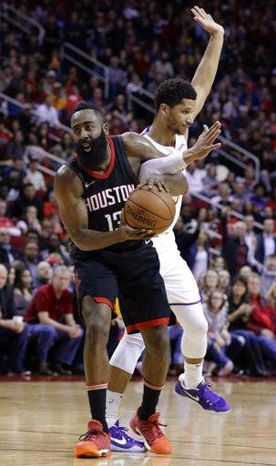 Houston Rockets guard James Harden (13) is fouled by Los Angeles Lakers guard Josh Hart during the second half of an NBA basketball game Sunday, Dec. 31, 2017, in Houston. (AP Photo/Michael Wyke)