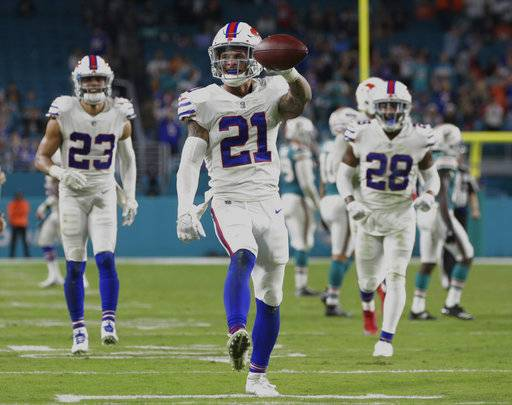 Buffalo Bills free safety Jordan Poyer (21) shows the ball after he intercepted a pass late in the second half of an NFL football game against the Miami Dolphins, Sunday, Dec. 31, 2017, in Miami Gardens, Fla. The Bills defeated the Dolphins 22-16. (AP Photo/Lynne Sladky)