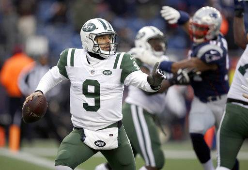 New York Jets quarterback Bryce Petty (9) scrambles under pressure from New England Patriots defensive end Deatrich Wise, right, during the second half of an NFL football game, Sunday, Dec. 31, 2017, in Foxborough, Mass. (AP Photo/Charles Krupa)