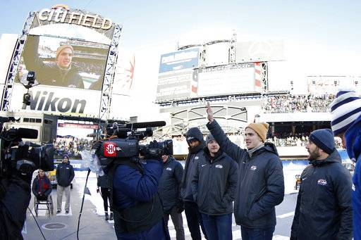 Troy Terry waves to the crowd as the roster for the men's USA Olympic hockey team is announced at the NHL Winter Classic hockey game between the Buffalo Sabres and the New York Rangers at CitiField in New York on Monday, Jan. 1, 2018. (AP Photo/Adam Hunger)