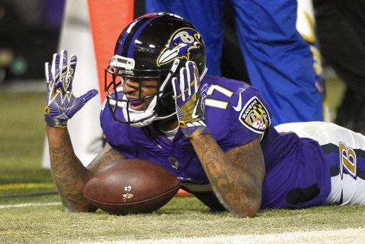 Baltimore Ravens wide receiver Mike Wallace (17) celebrates his touchdown during the second half of an NFL football game against the Cincinnati Bengals in Baltimore, Sunday, Dec 31, 2017. (AP Photo/Nick Wass)