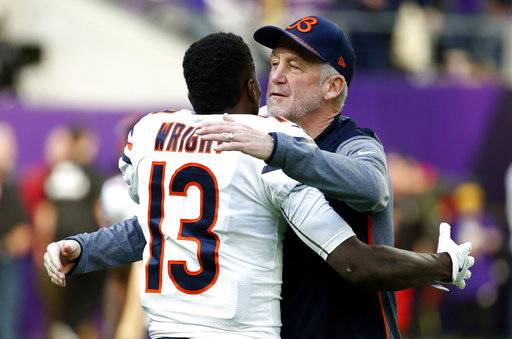 Chicago Bears head coach John Fox hugs wide receiver Kendall Wright (13) before an NFL football game against the Minnesota Vikings, Sunday, Dec. 31, 2017, in Minneapolis. (AP Photo/Bruce Kluckhohn)