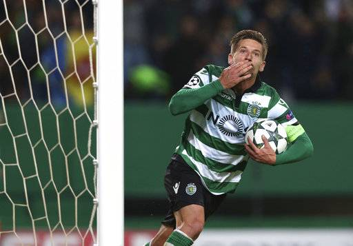 FILE - In this file photo dated Tuesday, Nov. 22, 2016, Sporting's Adrien Silva celebrates scoring during a Champions League, Group F soccer match between Sporting CP and Real Madrid at the Alvalade stadium in Lisbon. Leicester bought Silva from Sporting Lisbon on transfer deadline day in August 2017, but did not register the deal with FIFA on time, so now Monday Jan. 1, 2018, four months after signing, Silva is finally ready to play for the English Premier League club. (AP Photo/Steven Governo, FILE)