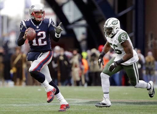 New England Patriots quarterback Tom Brady scrambles away from New York Jets linebacker Demario Davis (56) during the first half of an NFL football game, Sunday, Dec. 31, 2017, in Foxborough, Mass. (AP Photo/Steven Senne)