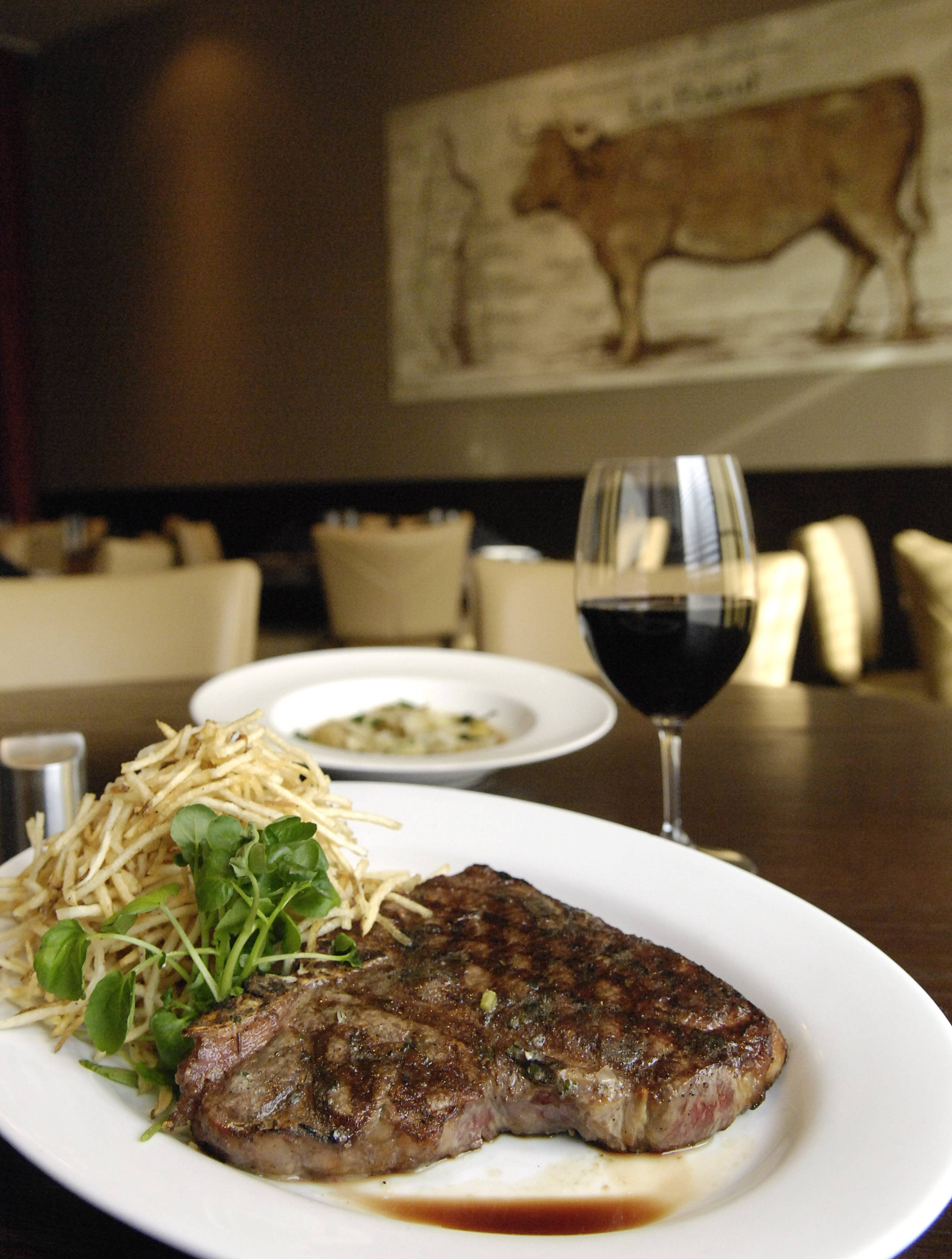 Laura Stoecker/lstoecker@dailyherald.com T-Bone steak with herb butter and shoestring potatoes is on the menu at T-Bones restaurant located at 1890 W. Main St. in St. Charles.