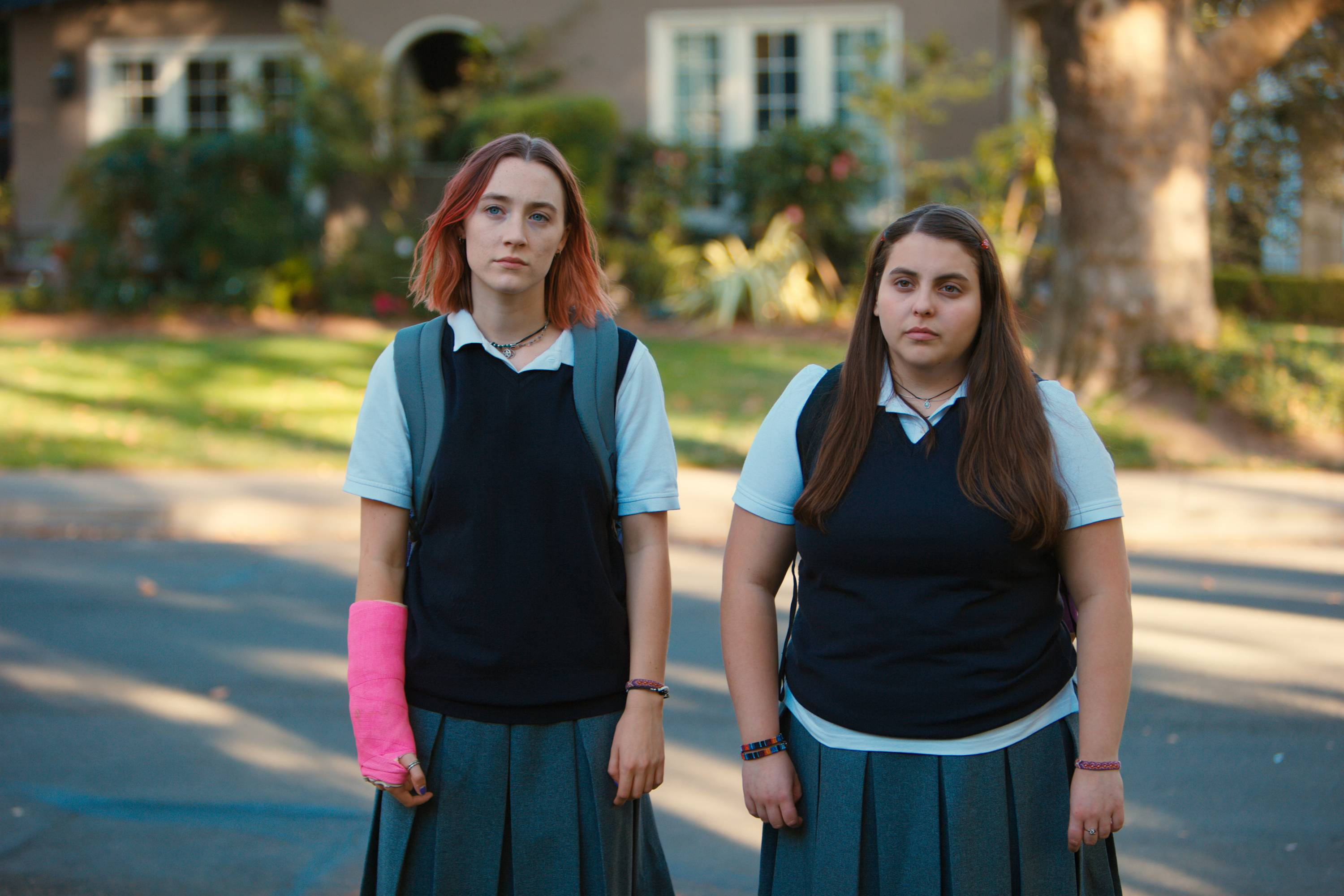 "Saoirse Ronan, left, and Beanie Feldstein star in ""Lady Bird."" Ronan says she hopes that ""Lady Bird"" helps people to feel understood in the same way the HBO show ""Girls"" helped her. Her performance has earned her some of the best reviews of her career and could result in a third Oscar nomination for the 23-year-old Irish actress."