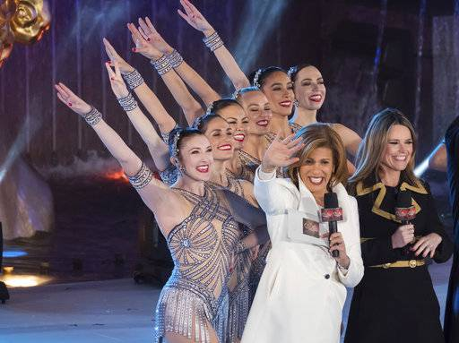 "FILE - In this Nov. 29, 2017, file photo, Savannah Guthrie, right, and Hoda Kotb appear with the Rockettes during the 85th annual Rockefeller Center Christmas Tree lighting ceremony in New York. NBC News opened the new year by appointing Kotb as co-anchor of the ""Today� show's first two hours with Guthrie, replacing Matt Lauer following his firing on sexual misconduct charges in late November. (Photo by Charles Sykes/Invision/AP, File)"