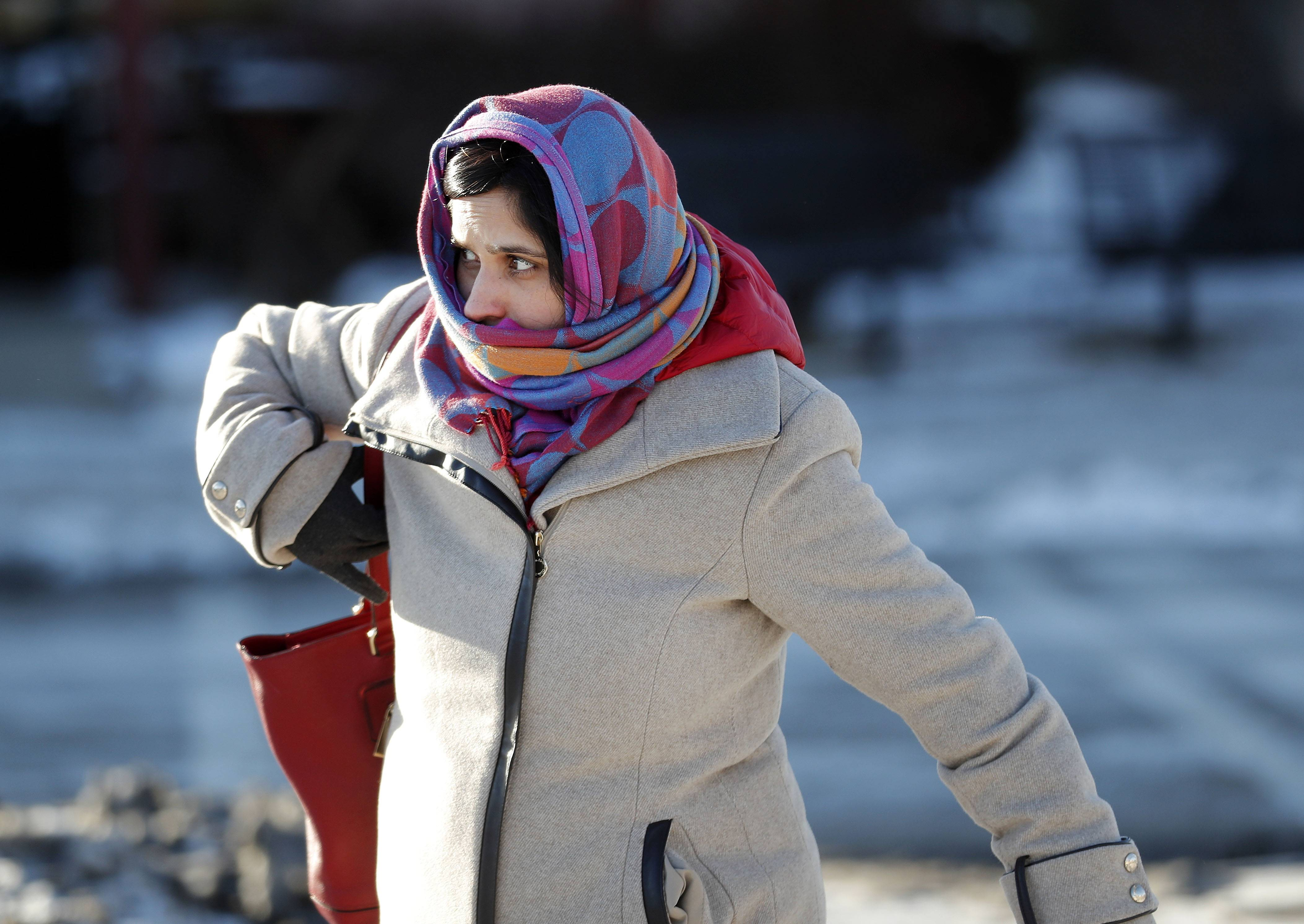 Devyani Bedekar of Vernon Hills is bundled up Tuesday as she walks to her car from the Metra stop in Libertyville.