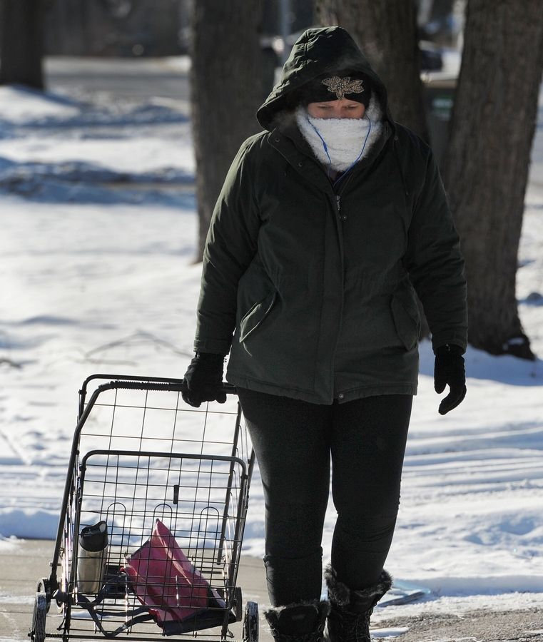 "Tracy Blethen of Palatine walk to the grocery store in subzero temperatures on Tuesday. She said she was ""trying to exercise with a purpose"" and described the cold as ""fine -- just dress warmer."""
