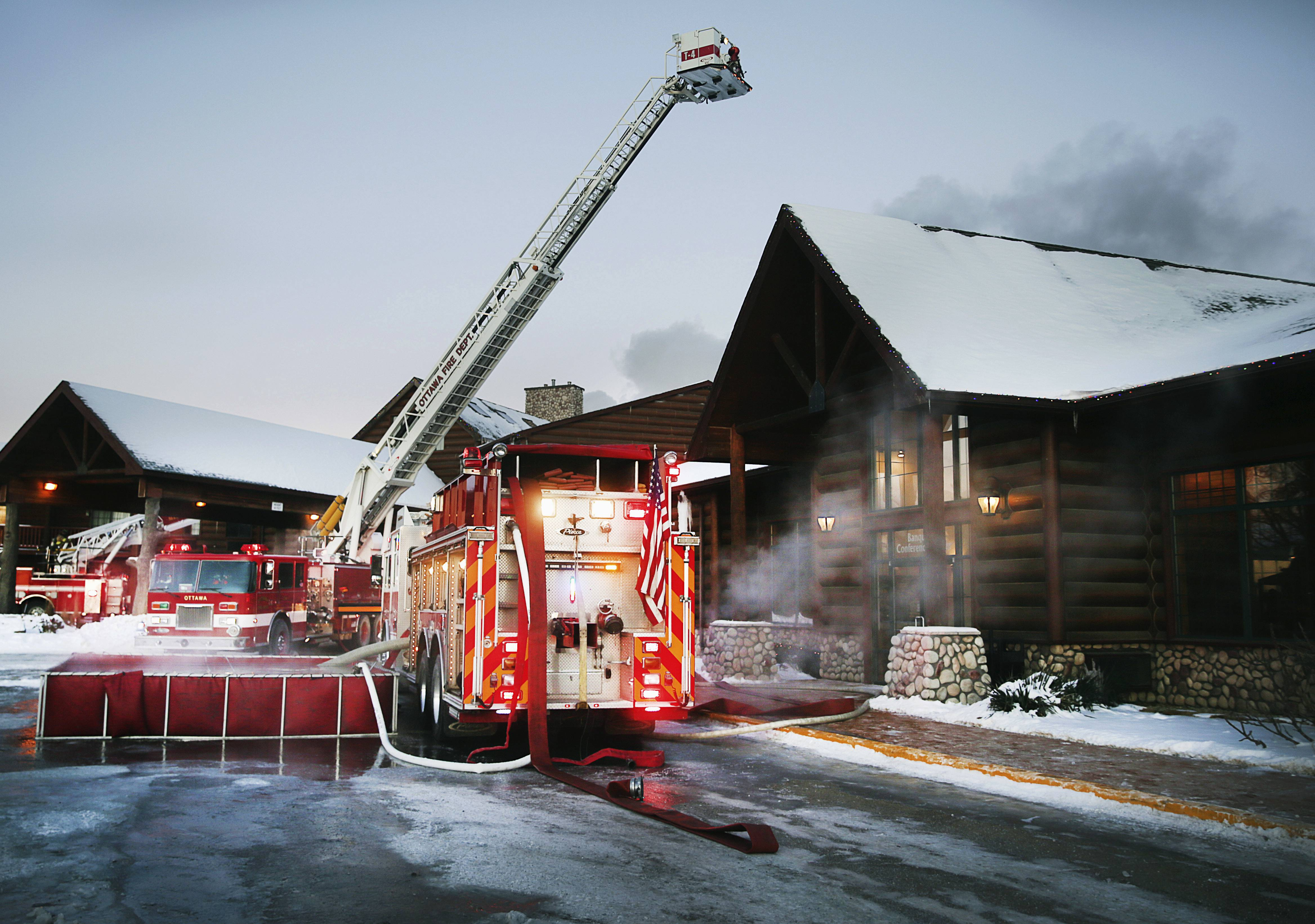 Firefighters battle a blaze at Grand Bear Lodge in Utica early Tuesday. Multiple fire departments responded to the fire that officials say was in the resort's main lodge and nearby pool. They had no information on injuries.