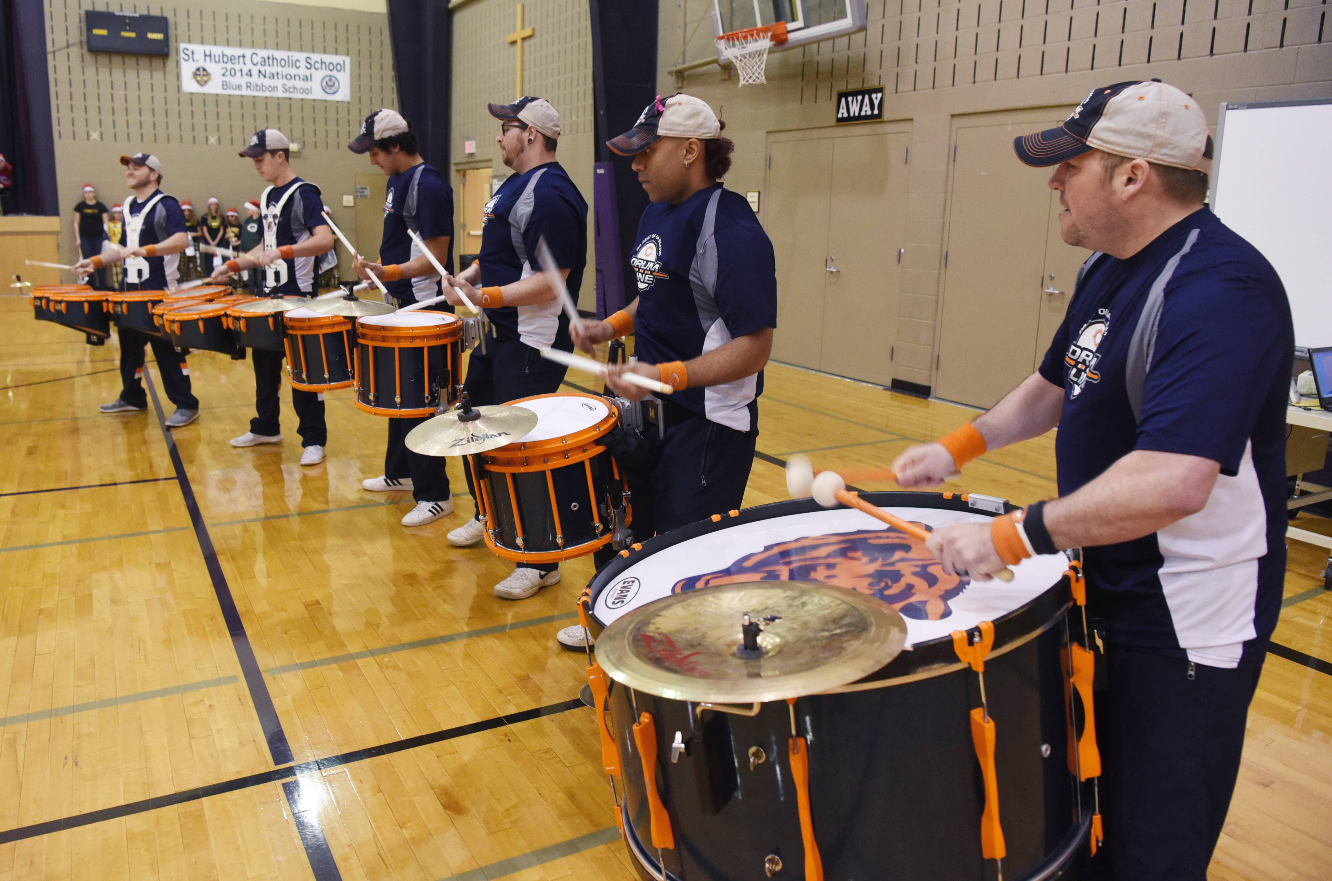 "The Chicago Bears drum line helps kick off a celebration announcing that St. Hubert School in Hoffman Estates won first place in the ""Soup-er Stadium Challenge,"" which collected food for Catholic Charities food pantries in Cook and Lake counties."