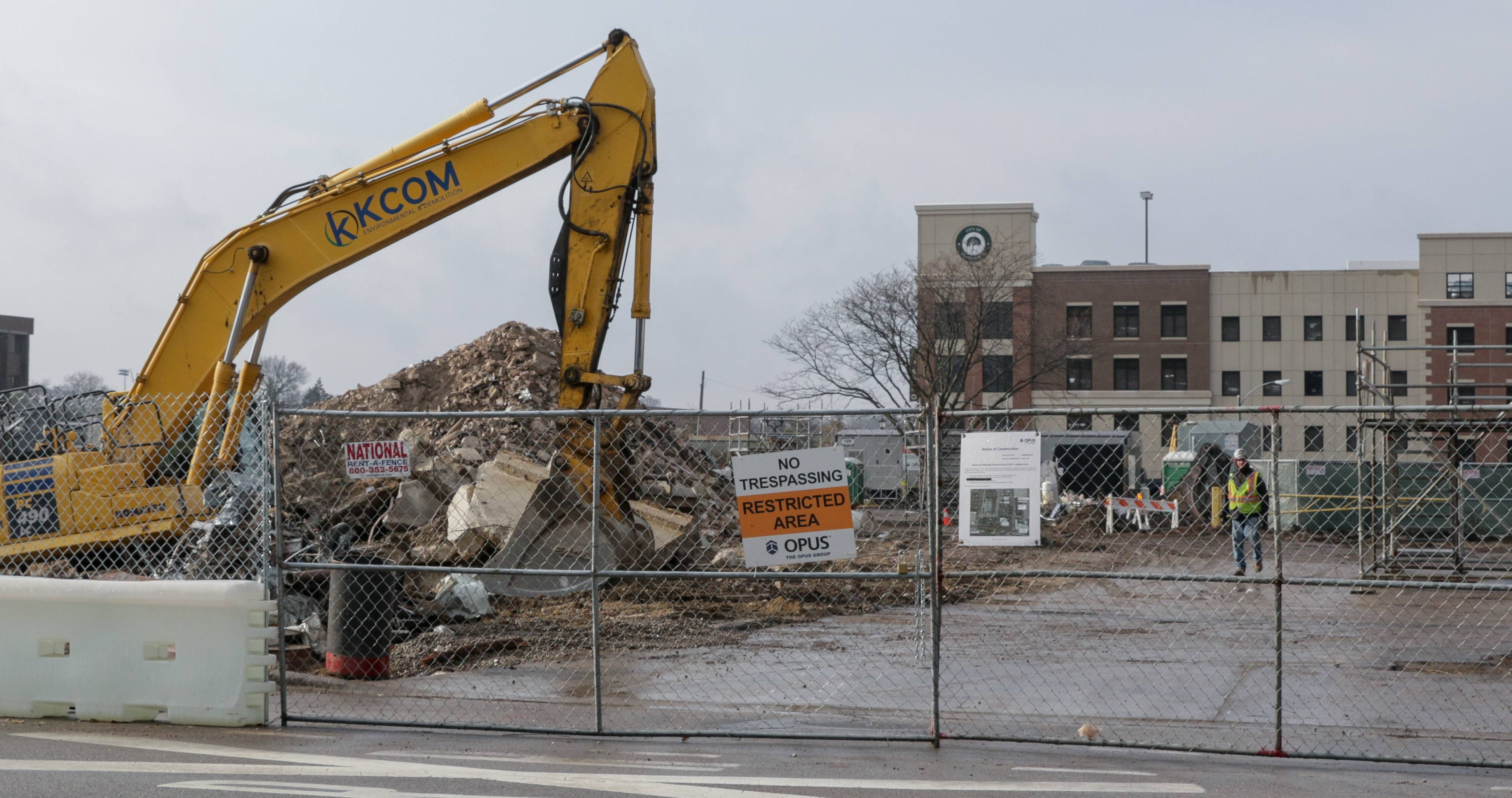 Crews recently demolished a bank in downtown Elmhurst to make way for a new apartment and retail complex that will take shape in 2018.