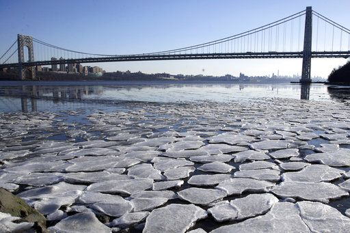 A layer of ice is broken into pieces floating along the banks of the Hudson River at the Palisades Interstate Park with the George Washington Bridge in the background, Tuesday, Jan. 2, 2018, in Fort Lee, N.J. The Northern New Jersey region continued to experienced deep cold weather to start the new year.