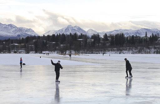 FILE - In this Jan. 2, 2018, file photo, ice skaters take advantage of unseasonable warm temperatures to ice skate outside at Westchester Lagoon in Anchorage, Alaska. While a large part of the county is freezing under Alaska-like conditions, parts of the nation's northernmost state were basking in balmy conditions Tuesday, Dec. 2, 2017. And Anchorage residents took full advantages, running in light shirts on their lunch hour, ice skating outdoors with only T-shirts on or playing hockey in a sweatshirt.