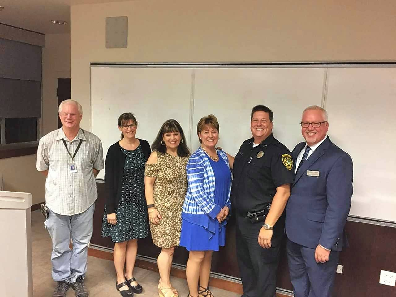Pictured, from left, are Larry Winters, auditorium manager, Streamwood High School; Michele Chapman-Simmons, principal Streamwood High School; Mary Jo Imperato, Hanover Township Food Pantry; Terri Channer, WINGS; Officer Ed Polaski, DARE; and John Parquette, Hanover Township Youth & Family Services.