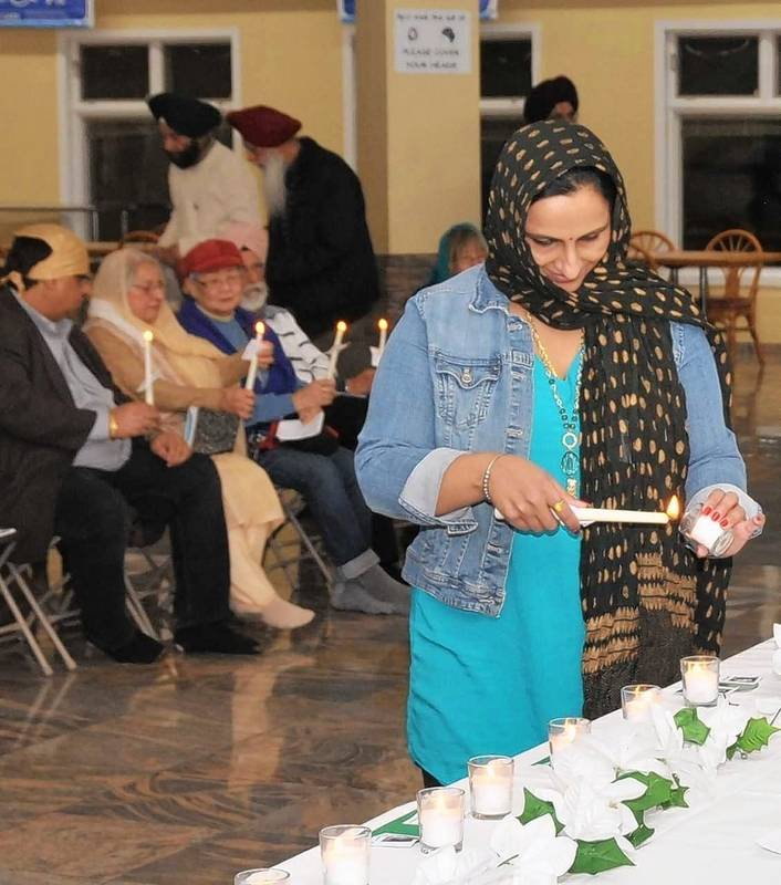 During a vigil at the Sikh Gurdwara in Palatine, a candle was lit to honor each of the 26 victims of gun violence at Sandy Hook.