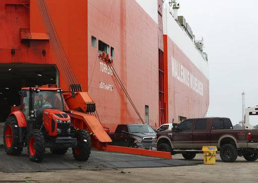 A Port of Galveston employee unloads a tractor from a ship on the east end of the port on Thursday, Dec. 21, 2017.  When Rodger Rees arrives as the Port of Galveston's new director this month, he'll be greeted by a board and a community with high expectations he'll shape a broad vision for the public docks. But his first concern must be in the fine details, several wharves board trustees said.  (Kelsey Walling /The Galveston County Daily News via AP)