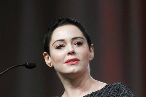 "FILE- In this Oct. 27, 2017, file photo, actress Rose McGowan speaks at the inaugural Women's Convention in Detroit. Actress and activist McGowan will be the subject of a new documentary TV series. E! said Tuesday, Jan. 2, 2017,  it will air the first part of ""Citizen Rose� on Jan. 30, which coincides with the release of her memoir, ""Brave.�"