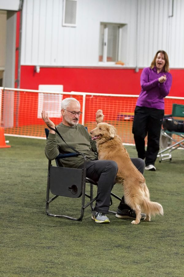 Steve Cannon and his Nova Scotia Duck Tolling Retriever, Maisie, won the musical chairs game at the 10th anniversary party of Spot On K9 Sports.