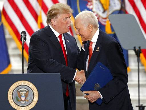 "FILE - In this Dec. 4, 2017, file photo, President Donald Trump shakes Sen. Orrin Hatch, R-Utah, hand at the Utah State Capitol in Salt Lake City. Hatch says he will not seek re-election after serving more than 40 years in the U.S. Senate. Hatch, 83, says he's always been a fighter, ""but every good fighter knows when to hang up the gloves.� (AP Photo/Rick Bowmer, File)"