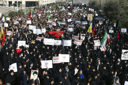 In this Dec. 30, 2017, photo, Iranian protesters chant slogans at a rally in Tehran, Iran. The Trump administration is calling on Iran's government to stop blocking Instagram and other popular social media sites as Iranians demonstrate in the streets. (AP Photo/Ebrahim Noroozi)