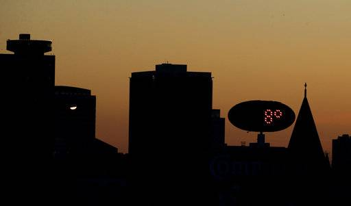 Temperatures approach the high for the day 8 Fahrenheit (-13 Celsius) as the sun sets Monday, Jan. 1, 2018, behind downtown Kansas City, Mo. Bone-chilling cold gripped much of the central U.S. as 2018 began Monday, breaking low temperature records, icing over some New Year's celebrations and leading to at least two deaths attributed to exposure to the elements.