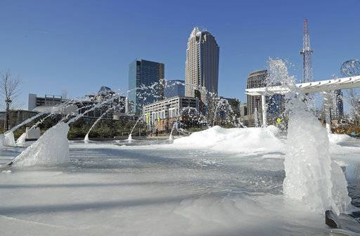 Water squirts from a frozen fountain near downtown in Charlotte, N.C., Tuesday, Jan. 2, 2018. Temperatures plummeted overnight to 2 degrees in the north Georgia mountains, 14 in Atlanta and 26 as far south as New Orleans as the Gulf Coast felt more like Green Bay.