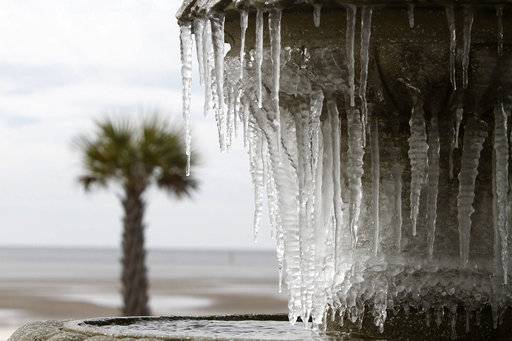 Icicles hang from the fountain at Beau View condominiums in Biloxi, Miss., on Monday, Jan. 1, 2018. A hard freeze hit South Mississippi overnight and temperatures are expected to remain near or below freezing for the rest of the week.(John Fitzhugh/The Sun Herald via AP)/The Sun Herald via AP)