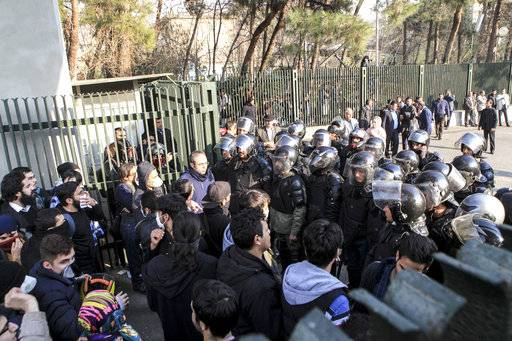 In this photo taken by an individual not employed by the Associated Press and obtained by the AP outside Iran, anti-riot Iranian police prevent university students to join other protesters over Iran weak economy, in Tehran, Iran, Saturday, Dec. 30, 2017. A wave of spontaneous protests over Iran's weak economy swept into Tehran on Saturday, with college students and others chanting against the government just hours after hard-liners held their own rally in support of the Islamic Republic's clerical establishment. (AP Photo)