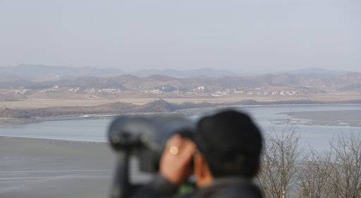 A visitor uses binoculars to see the North Korea side from the unification observatory in Paju, South Korea, Monday, Jan. 1, 2018. North Korean leader Kim Jong Un said Monday the United States should be aware that his country's nuclear forces are now a reality, not a threat. But he also struck a conciliatory tone in his New Year's address, wishing success for the Winter Olympics set to begin in the South in February and suggesting the North may send a delegation to participate.