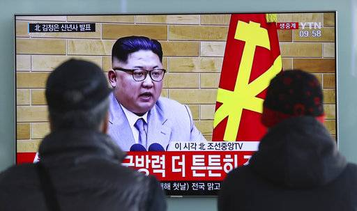"South Koreans watch a TV news program showing North Korean leader Kim Jong Un's New Year's speech, at the Seoul Railway Station in Seoul, South Korea, Monday, Jan. 1, 2018. The letters read on top left, ""Kim Jong Un delivers New Year's speech.""  Kim said Monday the United States should be aware that his country's nuclear forces are now a reality, not a threat. But he also struck a conciliatory tone in his New Year's address, wishing success for the Winter Olympics set to begin in the South in February and suggesting the North may send a delegation to participate."