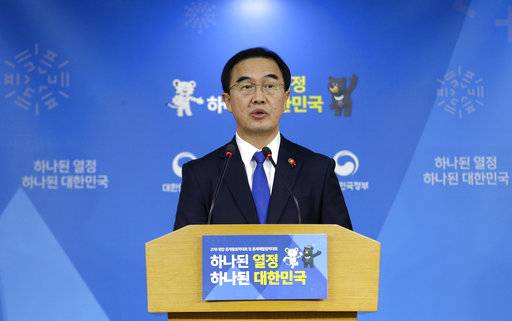 "South Korean Unification Minster Cho Myoung-gyon speaks during a press conference at the government complex in Seoul, South Korea, Tuesday, Jan. 2, 2018. Cho on Tuesday offered high-level talks with rival North Korea meant to find ways to cooperate on the Winter Olympics set to begin in the South next month. The banner showing the 2018 Pyeongchang Winter Olympic slogan reads: ""Passion. Connected."""