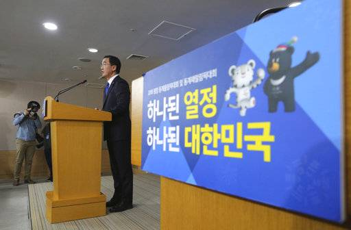 "South Korean Unification Minster Cho Myoung-gyon speaks during a press conference at the government complex in Seoul, South Korea, Tuesday, Jan. 2, 2018. Cho on Tuesday offered high-level talks with rival North Korea meant to find ways to cooperate on the Winter Olympics set to begin in the South next month. The banner showing the 2018 Pyeongchang Winter Olympics slogan reads: ""Passion. Connected."""
