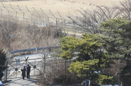 Visitors stand near the military wire fence at the Imjingak Pavilion in Paju, South Korea, Monday, Jan. 1, 2018. North Korean leader Kim Jong Un said Monday the United States should be aware that his country's nuclear forces are now a reality, not a threat. But he also struck a conciliatory tone in his New Year's address, wishing success for the Winter Olympics set to begin in the South in February and suggesting the North may send a delegation to participate.