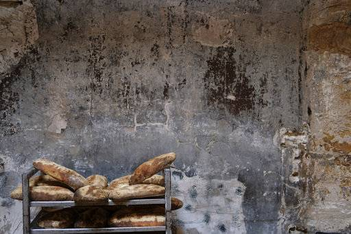 "In this Nov. 9, 2017 photo, bread cooked with a wood-burning oven sits at Proper restaurant in Buenos Aires, Argentina. ""Fire is a very strong part of Argentina's identity,"" said Augusto Mayer, who launched Proper last year with fellow chef Leo Lanussol. ""We have a bunch of ways of cooking with wood and we're harnessing the potential of that type of cooking."""
