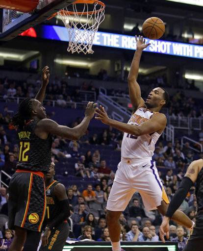 Phoenix Suns forward TJ Warren (12) drives on Atlanta Hawks forward Taurean Prince during the second half during an NBA basketball game Tuesday, Jan. 2, 2018, in Phoenix. The Suns defeated the Hawks 104-103.