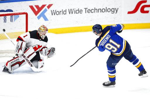 St. Louis Blues' Vladimir Tarasenko, right, of Russia, scores the game-winning goal past New Jersey Devils goaltender Keith Kinkaid during a shootout in an NHL hockey game Tuesday, Jan. 2, 2018, in St. Louis. The Blues won 3-2.