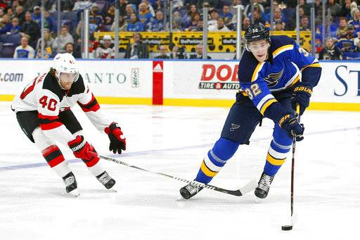 St. Louis Blues' Tage Thompson, right, gains control of the puck as he is pressured by New Jersey Devils' Blake Coleman during the second period of an NHL hockey game Tuesday, Jan. 2, 2018, in St. Louis.