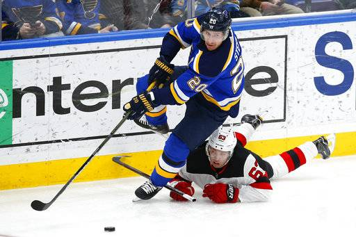 St. Louis Blues' Alexander Steen skates with the puck as New Jersey Devils' Jesper Bratt, right, of Sweden, falls to the ice as he gives chase during the third period of an NHL hockey game Tuesday, Jan. 2, 2018, in St. Louis. The Blues won 3-2 in a shootout.