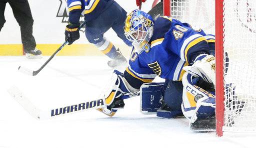 St. Louis Blues goaltender Carter Hutton makes a leg save on a rebound opportunity from a shot that went off the post in overtime during overtime in an NHL hockey game, Tuesday, Jan. 2, 2018, at the Scottrade Center in St. Louis. (Chris Lee/St. Louis Post-Dispatch via AP)