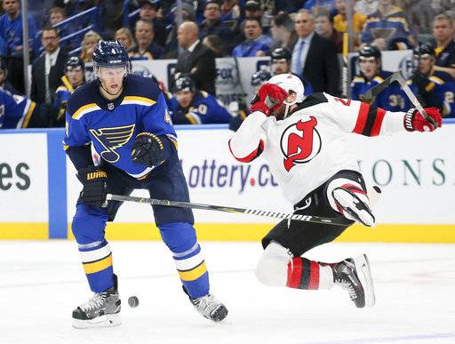 New Jersey Devils right wing Stefan Noesen is upended by St. Louis Blues defenseman Carl Gunnarsson during the third period of an NHL hockey game, Tuesday, Jan. 2, 2018, at the Scottrade Center in St. Louis. (Chris Lee/St. Louis Post-Dispatch via AP)