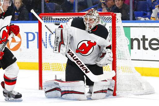 New Jersey Devils goaltender Keith Kinkaid keeps his eyes on a puck shot by the St. Louis Blues during the second period of an NHL hockey game Tuesday, Jan. 2, 2018, in St. Louis.