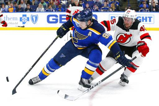 St. Louis Blues' Vladimir Tarasenko, left, of Russia, and New Jersey Devils' Sami Vatanen, of Finland, battle for a loose puck during the second period of an NHL hockey game Tuesday, Jan. 2, 2018, in St. Louis.