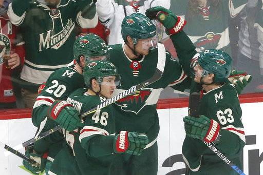 Minnesota Wild's Eric Staal, second from right, is congratulated by teammates after his goal off Florida Panthers goalie James Reimer during the second period of an NHL hockey game Tuesday, Jan. 2, 2018, in St. Paul, Minn.