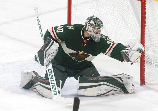 Minnesota Wild goalie Devan Dubnyk gloves a shot on goal during the first period of an NHL hockey game against the Florida Panthers on Tuesday, Jan. 2, 2018, in St. Paul, Minn.