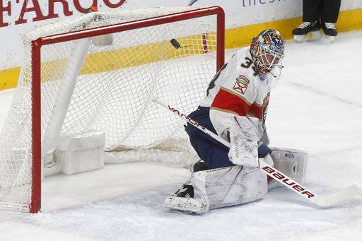Florida Panthers goalie James Reimer stops a Minnesota Wild shot during the first period of an NHL hockey game Tuesday, Jan. 2, 2018, in St. Paul, Minn.