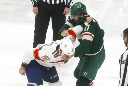 Florida Panthers' Micheal Haley, left, and Minnesota Wild's Marcus Foligno fight during the first period of an NHL hockey game Tuesday, Jan. 2, 2018, in St. Paul, Minn.