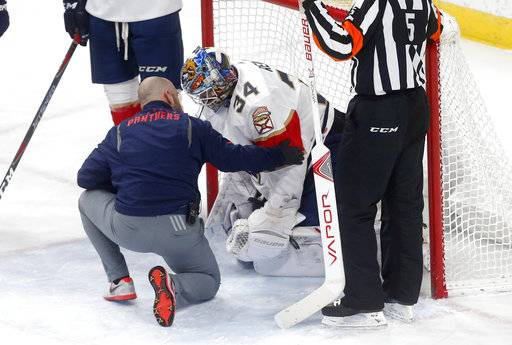 Florida Panthers goalie James Reimer receives attention during the second period of an NHL hockey game Tuesday, Jan. 2, 2018, in St. Paul, Minn., after Minnesota Wild's Mikael Granlund landed on him.